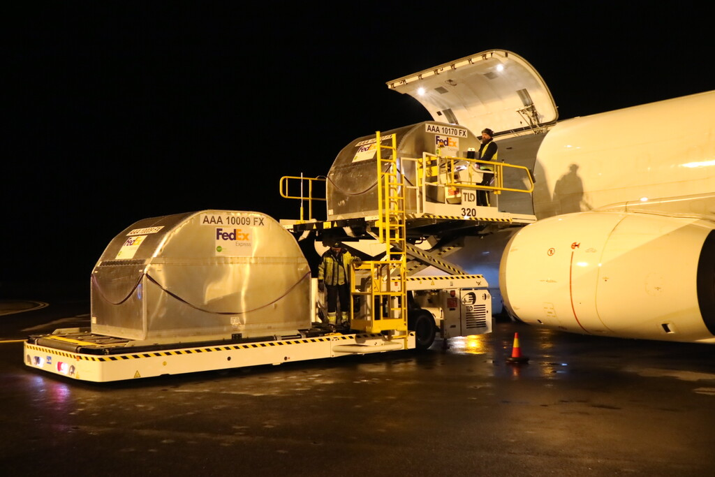 Containers are unloaded from cargo planes