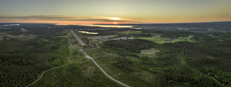 Drone image taken in the south from the runway with sunrise in Lake Vättern and over Jönköping